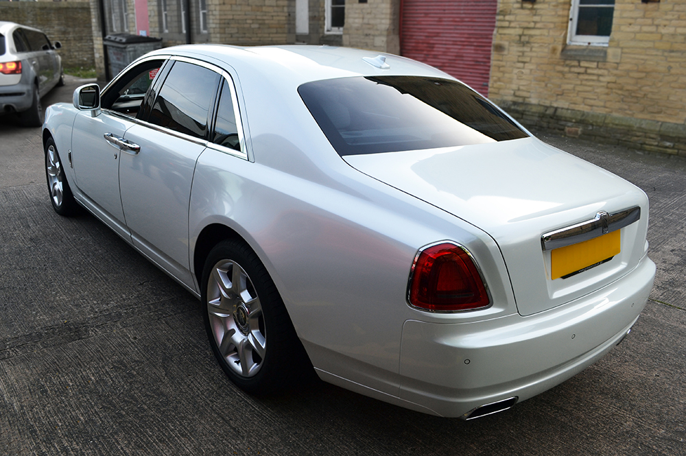 Rolls Royce Ghost wrapped in Pearl White - Reforma UK