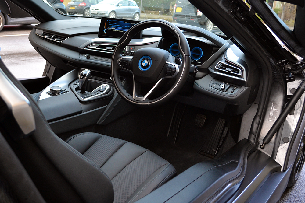 Bmw i8 matte black wrap reforma uk for Bmw i8 interior
