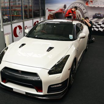Nissan GTR White Carbon Nismo Red Spoiler Fitting