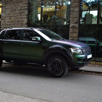 ford raptor wrapped urban jungle reflection