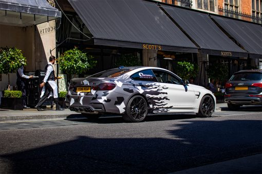 BMW M4 Coupe Crushed Carbon Vehicle Wrap Rear Three Quarter