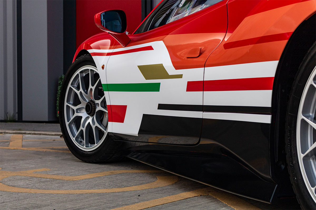 <h3></noscript>Ferrari 488 Challenge Racing Livery</h3><p>Full Ferrari 488 Challenge racing livery, featuring a primary gloss white stripe, offset with bold red, green and orange detailing. Price includes supply and fitting.</p><h4>from <span>£800</span><br />inc. VAT</h4>
